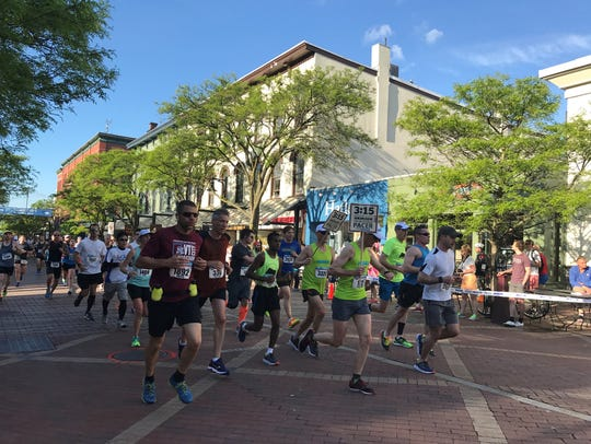 Runners make their way down the Church Street Marketplace