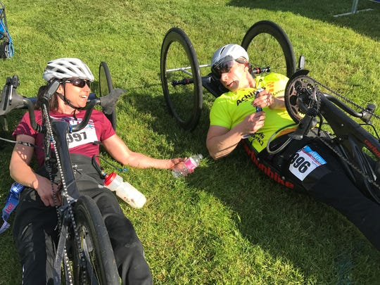 Alicia Dana of Putney, left, and Krys Zybowski of Avon, Conn., talk after crossing the finish line at the Vermont City Marathon in Burlington, Sunday, May 28, 2017. Zybowski just edged out Dana to finish first in the handcycle division of the race.