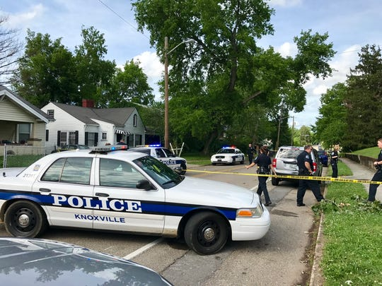 "Police respond to a shooting on East Fifth Avenue on Sunday, May 28, 2017. Police say Charles ""Chucky"" N. Brown was shot in his front yard before staggering across the street and collapsing."