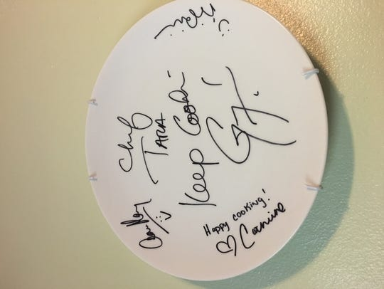 Tara Beam was given an autographed plate from the judges