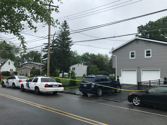 The New Jersey State Police cordoned off this home at the corner of Brady and N. Cherry roads in Jefferson, near Lake Hopatcong, Monday, May 29, after a state trooper shot and wounded a resident who allegedly charged responding troopers investigating a domestic assault.