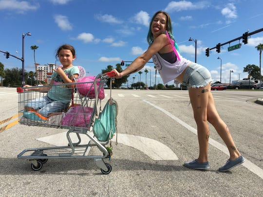 Spunky heroine Moonee (Brooklynn Prince) and her struggling single mom Halley (Bria Vinaite) are at the heart of festival favorite 'The Florida Project.'