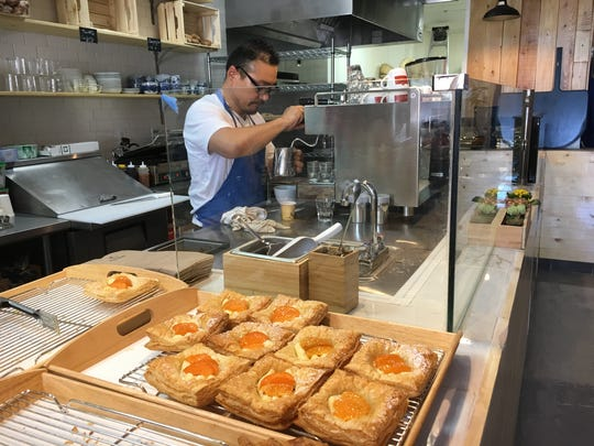 Cafe du Suro owner David Lee prepares a coffee drink at the Ventura bakery, which also offers pastries and artisanal bread.