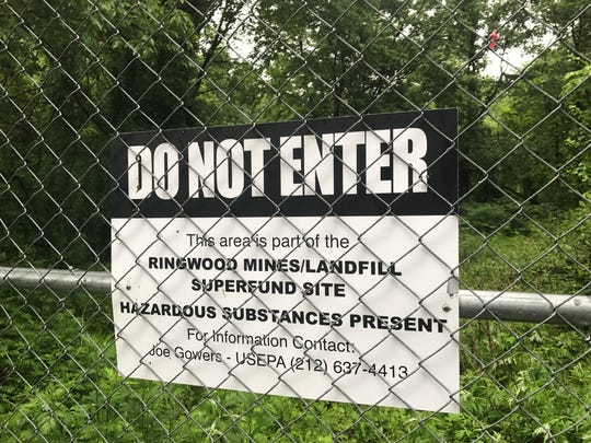 The Ringwood Superfund site sits behind chain-link