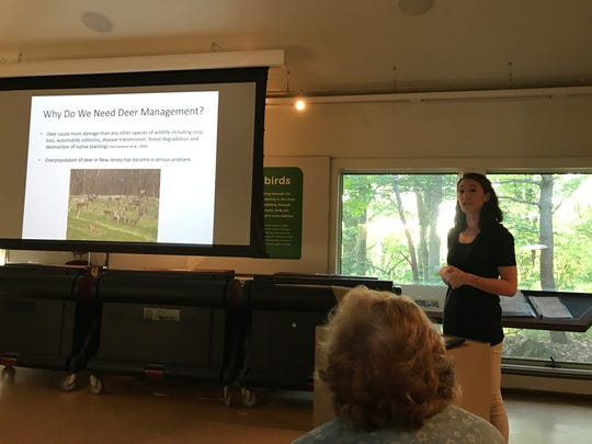 Flat Rock Brook Nature Center Land Manager Erin Casella talks about the center's plans to install a fence intended to keep deer out of the bulk of the nature preserve at a community meeting May 31.