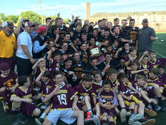 Youth players help Madison celebrate the first NJSIAA