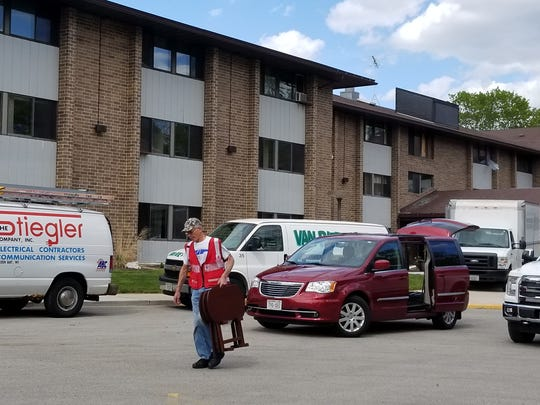 Volunteers for the Salvation Army assist Parkview Haven apartment residents with moving their belongings out of the building May 31, 2017.