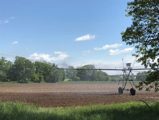A center pivot irrigation system waters crops near Waupaca in the Central Sands region of the state. Opponents say wells like this deplete lakes and streams.