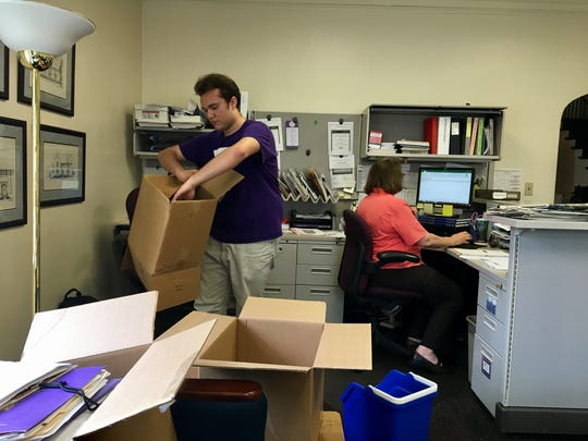 Rafael Pereira breaks down boxes at his campus job at the University of Evansville's Alumni Relations office.