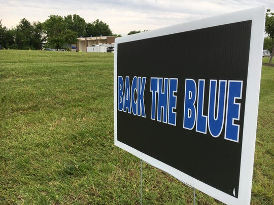 """A sign welcomes the public to a """"Back the Blue"""" fundraiser for the Delaware State Troopers Association at the Dover DMV on Saturday."""