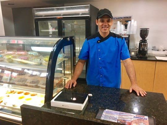 "Jorge Diaz Matos owns the Cuban American Cafe in Cape Coral. ""People are so surprised,"" he says when people discover the restaurant inside the Marathon gas station."