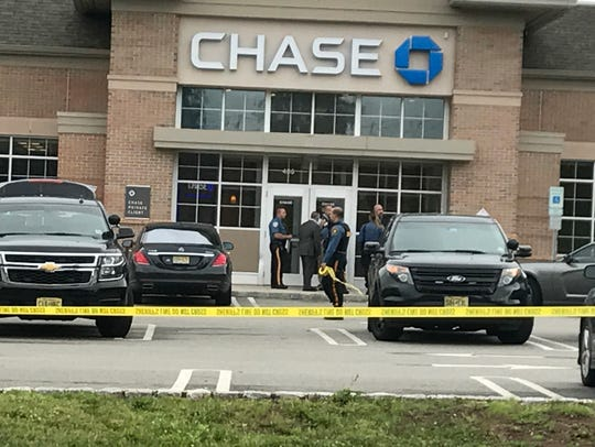 Law-enforcement at the scene of a bank robbery at Chase