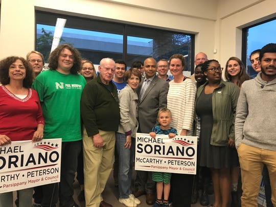 Parsippany mayoral candidate Michael Soriano, center,
