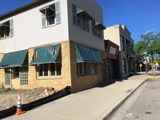 The building at 317 W. Main Street will be razed to make way for two new buildings, each with a restaurant on the lower level and office and residential space above.