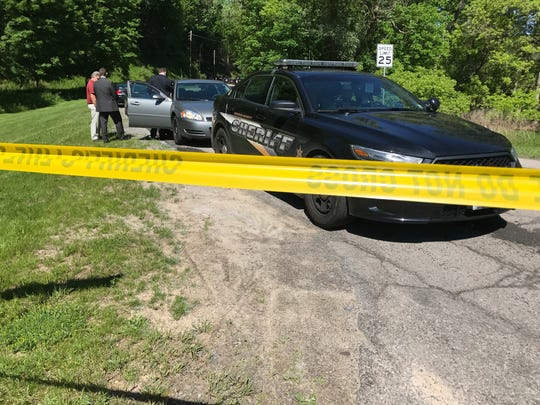 "Investigators on scene of an ""unattended death"" in Penfield Wednesday."