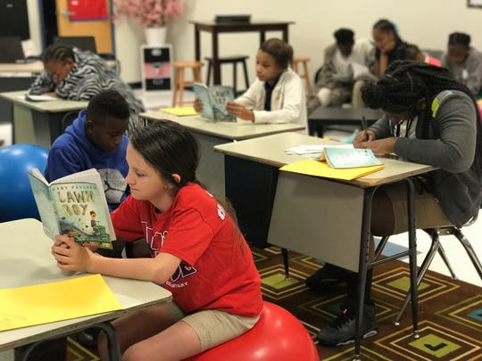 Students reading at literacy camp at Martin Park Elementary School.