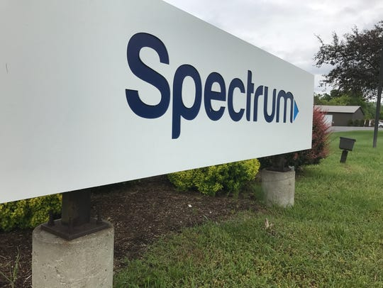 A Spectrum sign outside an office in the Binghamton