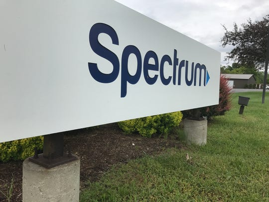 A Spectrum sign outside an office in the Binghamton area.