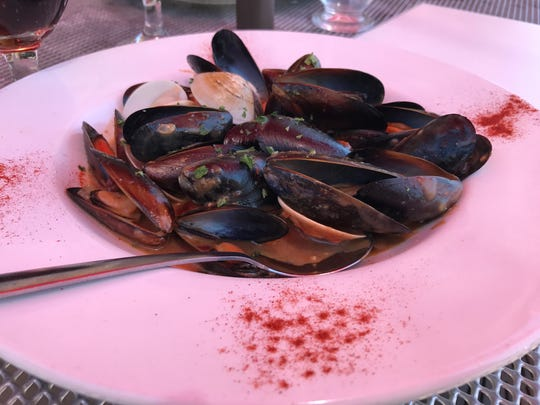 Mussels, clams and andouille  sausage are served at