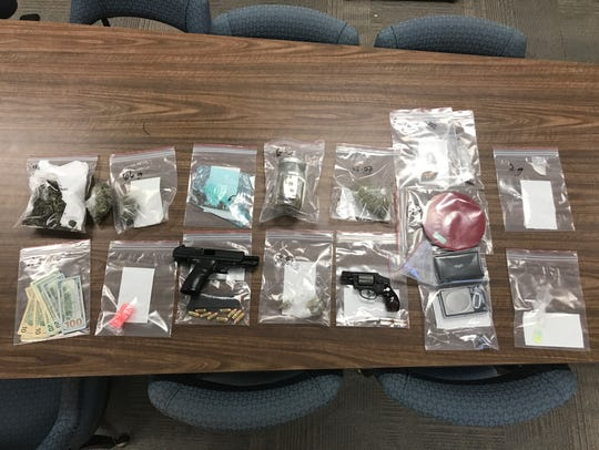 Drugs and a couple of handguns were confiscated in