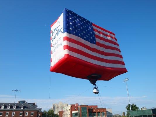 636326127094963638-flag-day-worlds-largest-flag-airborne.JPG