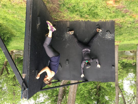 Chris Anne Myers and Courtney Kaczmark on a 'Z-Wall' set up for training in the Myers' back yard.