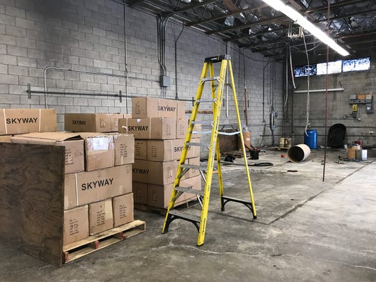 Boxes and a ladder sit where multi-ton injection molding presses used to be inside Skyway's manufacturing plant in Redding.