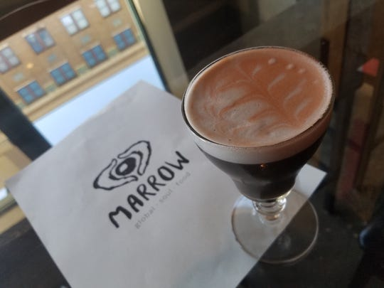 The Rorschach Sour at Marrow in Fountain Square gets its smokey hue and wee bit of salinity from -- wait for it -- squid ink. The drink also includes Cana Brava rum, lime, raspberry and egg white froth.