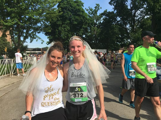 Alaina Nesbitt, left, and Melissa Flucke ran Saturday's Bellin Run in their veils. Both women have weddings in the next month.