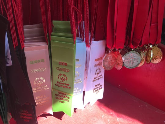 Ribbons and medals wait to be awarded during the Special Olympics Wisconsin State Summer Games on Saturday, June 10, 2017.