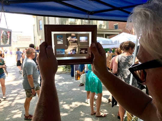Ryan Waelde shows off his photo slide art in the sunlight