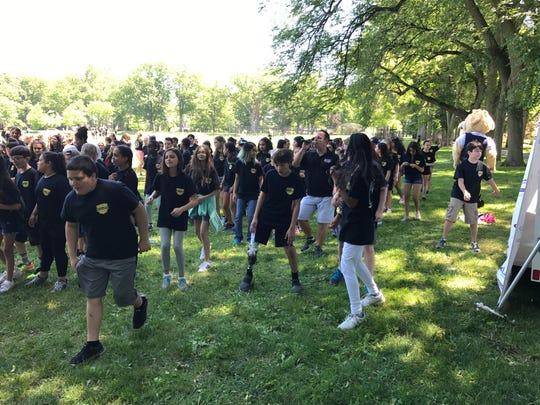 Nutley sixth-graders do the cha-cha line dance on June
