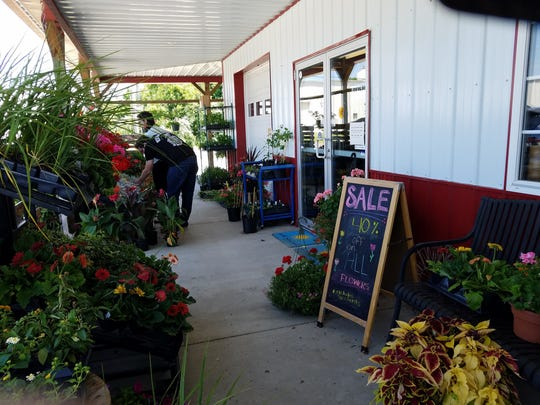 Farm 57 is a welcoming market and cafe with flowers,