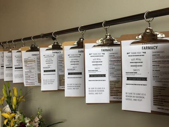 Clipboards hold the Farmacy menu.