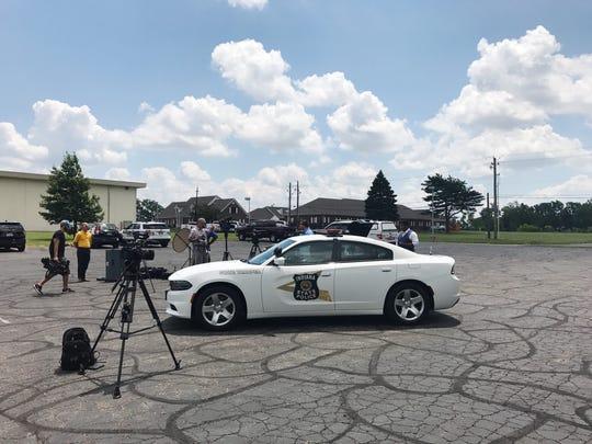 Sergeant John Perrine and Captain Mike Pruitt sit inside a 120 degree car to bring attention to the dangers of leaving children or pets in hot cars.