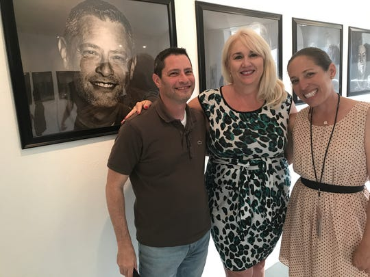 Palm Springs Unified School District Arts Coordinator Louisa Castrodale (center) with Palm Springs Public Art and Special Projects Coordinator Jennifer Henning and portrait subject Steven Biller in front of Biller's portrait.