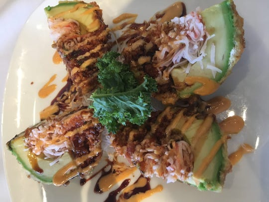 "Sushi Gen's most popular appetizer is ""Monkey Brain,"" which consists of fried avocado halves topped with crab, spicy tun and spicy mayo."