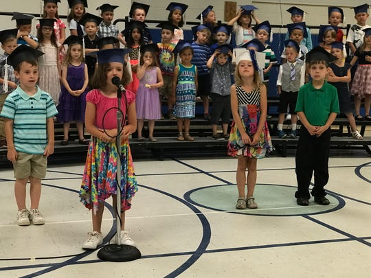 Kasidy Myers delivers her line while fellow kindergarteners