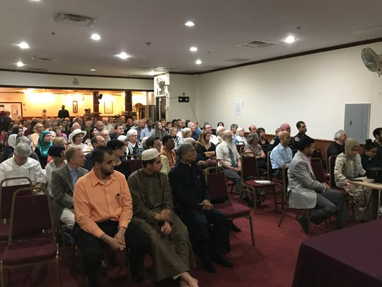 Members and guests representing many faiths attend an interfaith Iftar dinner and service at the Islamic Center of New Jersey in Rockaway on June 13, 2017.