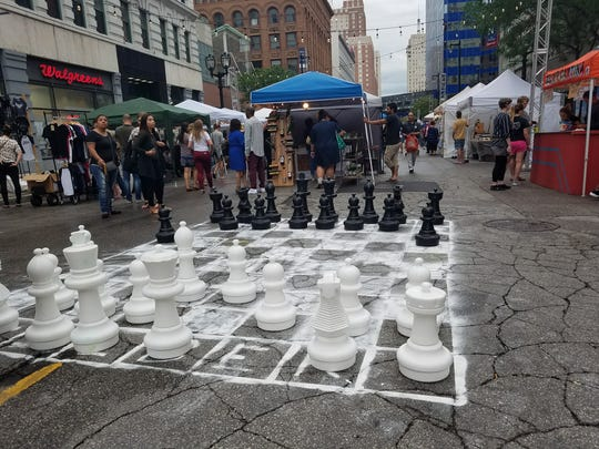 Night Market goers can play chess in the streets