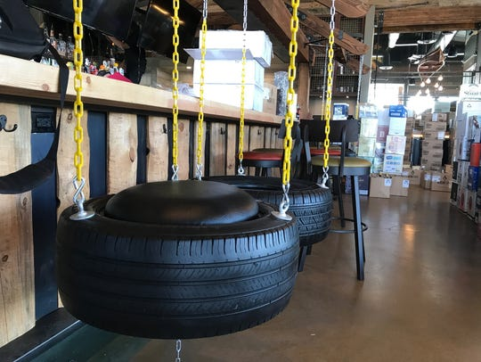 Tire swings hang from the bar at the center of the