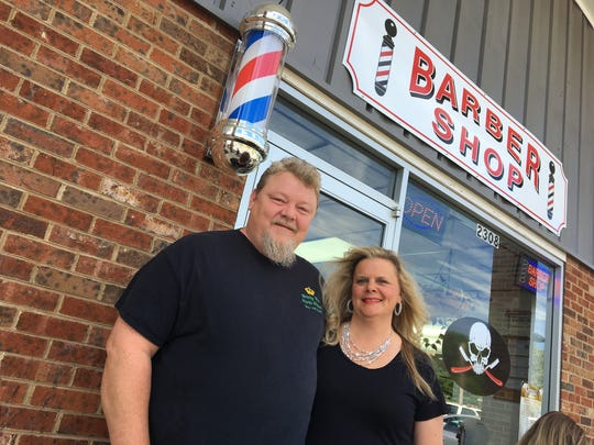 Joe and Holly Humphrey now own and operate the West End Barber Shop business in Staunton. They also own the thrift store — Nearly New Thrift Shoppe — just a few doors down.