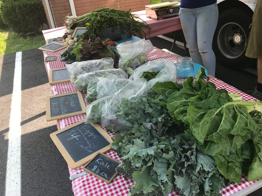 Lettuce and other veggies await customers at a City Green Mobile Farm Stand in Belleville on Tuesday, June 13, 2017.
