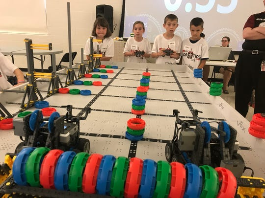 Students compete in a robotics challenge as part of a robotics camp at Mansfield Christian School Thursday.