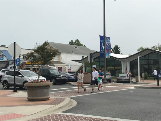 Pedestrians cross the street in Bethany Beach.