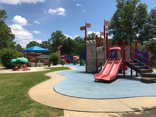 Jungle gyms at Roy Pope Memorial Park in Woodfin have a castle theme.