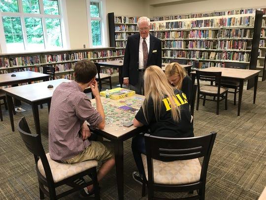 Library board member Douglas Ott speaks to students