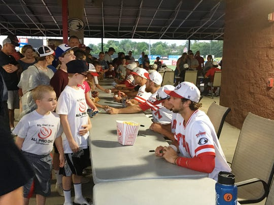 Florence Freedom players sign autographs for kids after a home game in 2017.