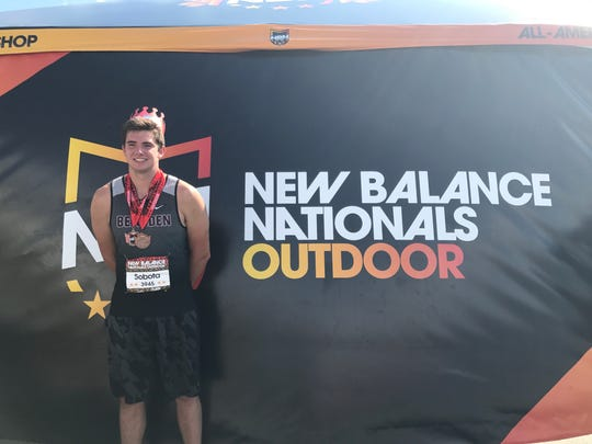 Bearden junior Joshua Sobota poses for pictures with his two medals during the New Balance National Outdoor Track and Field Championships in Greensboro, N.C.