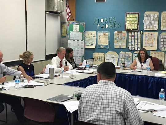 Board president Michael Sprague (center) speaks to parents at the June 19 meeting.
